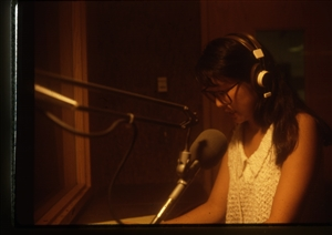 1987 WRSU Orientation Slide Show<br/>Ellie Yung in Announce Booth 1<br>Slide #05
