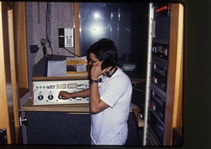 1987 WRSU Orientation Slide Show<br/>News Production with Mike Reed<br>Producer Console<br>Slide #08