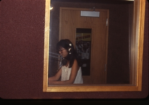 1987 WRSU Orientation Slide Show<br/>Ellie Yung Announce Booth 1<br>Slide #9