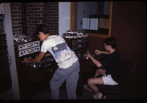 1987 WRSU Orientation Slide Show<br/>Editing Tapes on the Scully in Production<br>Unknown, Mike Reed<br>Slide #27