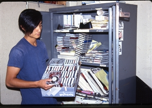 1987 WRSU Orientation Slide Show<br/>Production Team sorting carts in Production<br>Slide #28