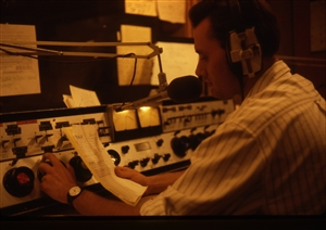 1987 WRSU Orientation Slide Show<br/>Reading an Accouncement<br>Slide #34_1
