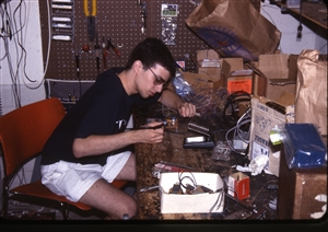 1987 WRSU Orientation Slide Show<br/>Soldering on the Tech Bench<br>Mike Reed<br>Slide #38